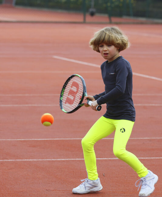 neon yellow long tennis leggings with ball pocket from zoe alexander uk